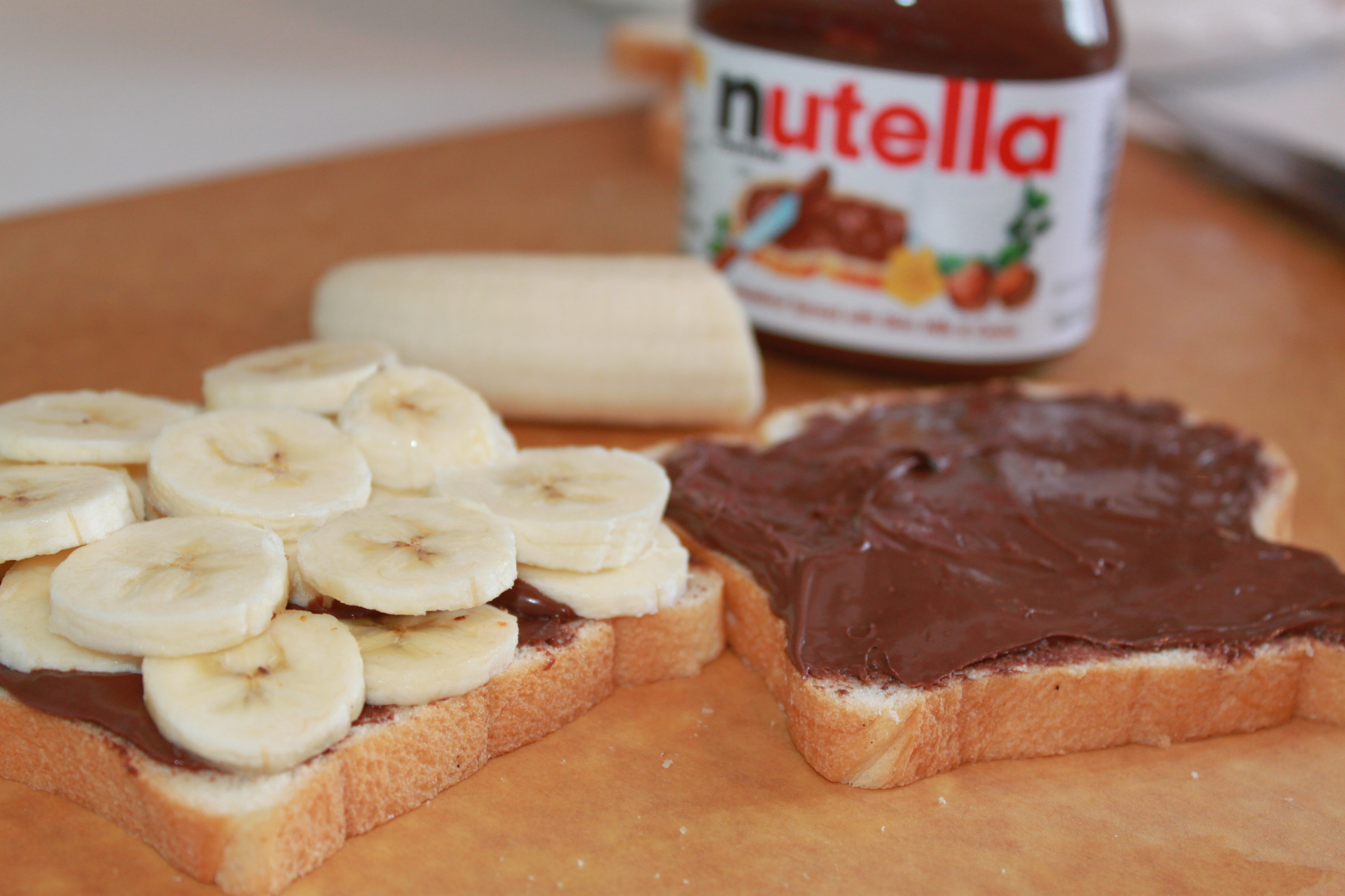 Pile the banana slices onto one half of the sandwich. Then spread yet ...