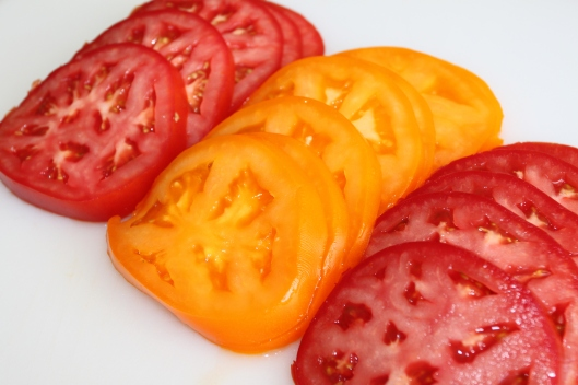 Start bymslicing fresh tomatoes. The colorful tomatoes at the store ...